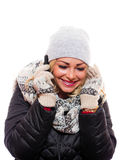 Woman listening on her cell phone smiling. A attractive woman is listening on her cell phone smiling while dressed for winter stock photo