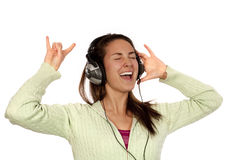 Woman listening loud music. Over white background wearing green t-shirt Stock Image