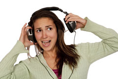 Woman listening loud music. Over white background wearing green t-shirt Royalty Free Stock Photography