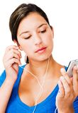 Woman listening mp3 Royalty Free Stock Photography