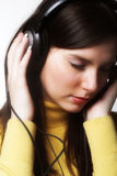 Woman listening music Stock Photo