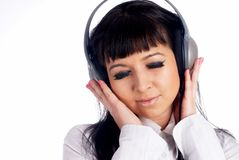 Woman listening music Stock Images