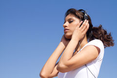 Woman listening music Stock Image