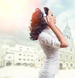 Woman listening music Stock Image