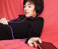 Woman listening music Royalty Free Stock Photos
