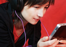 Woman listening music. Woman lying with digital tablet Royalty Free Stock Photography