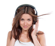 Woman listening music in big headphones Royalty Free Stock Photos