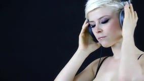 Woman listening music stock video footage