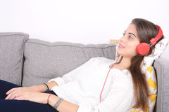 Woman listening music on couch. Stock Photo