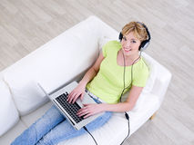 Woman listening music in headphone Stock Photography