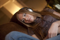 Woman listening music in headphones Royalty Free Stock Images