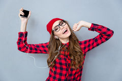Woman listening music in headphones and dancing Royalty Free Stock Photo