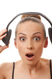 Woman listening music with headphones, on white Royalty Free Stock Photo
