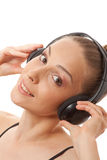 Woman listening music with headphones, on white Stock Photos