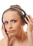 Woman listening music with headphones, on white Royalty Free Stock Photography