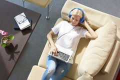 Woman listening music at home Stock Photo
