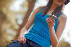 Woman listening music. On ipod Royalty Free Stock Photography