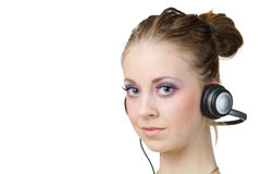 Woman listening music and looking at you Royalty Free Stock Photography