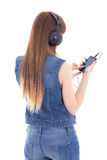 Woman listening music with mobile phone isolated on white Stock Photos