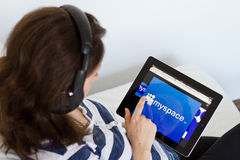 Woman listening music on Myspace. Website Royalty Free Stock Photography