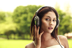 Woman listening music outdoor Royalty Free Stock Images