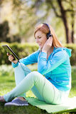 Woman listening music outdoors Stock Photos