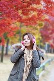 Woman listening music outdoors in autumn Stock Photography