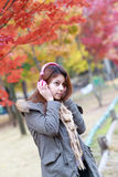Woman listening music outdoors in autumn Royalty Free Stock Photos