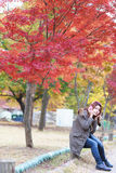 Woman listening music outdoors in autumn Royalty Free Stock Photography