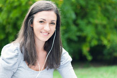Woman listening music at the park Royalty Free Stock Photos