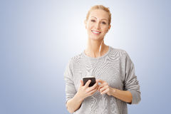 Woman listening music Stock Photos