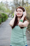 Woman listening music Royalty Free Stock Images