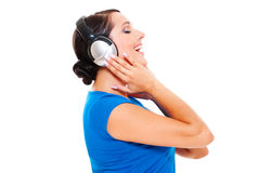 Woman listening music and singing Stock Photos