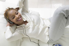 Woman Listening Music On Sofa Stock Images