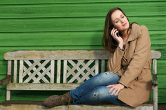Woman Listening on Phone Outdoors Stock Images