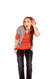 Woman Listening with Shock and Disbelief. A woman listening showing shock and disbelief stock photos