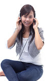 Woman listening sound from head phone Stock Photography