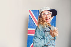 Woman listening to british music Stock Photos