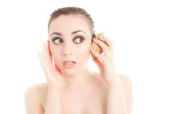 Woman listening to conch stock photography