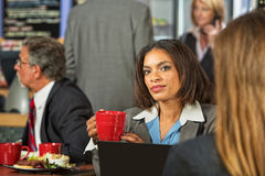 Woman Listening to Coworker Royalty Free Stock Photo