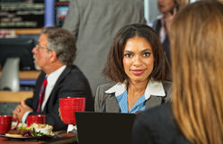 Woman Listening to Coworker Royalty Free Stock Image