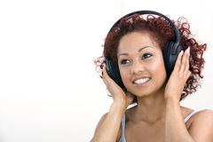 Woman listening to headphones Stock Images