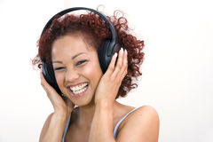 Woman listening to headphones Royalty Free Stock Images