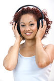 Woman listening to headphones Royalty Free Stock Image