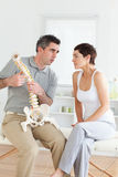 Woman listening to her chiropractor Royalty Free Stock Image