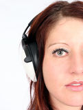 Woman listening to her favorite music Royalty Free Stock Images