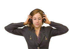 Woman listening to her headphones Royalty Free Stock Images