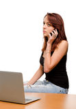 Woman listening to her mobile phone Stock Photos