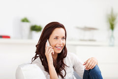 Woman listening to her mobile phone Royalty Free Stock Images