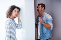 Woman listening to man screaming Royalty Free Stock Photos